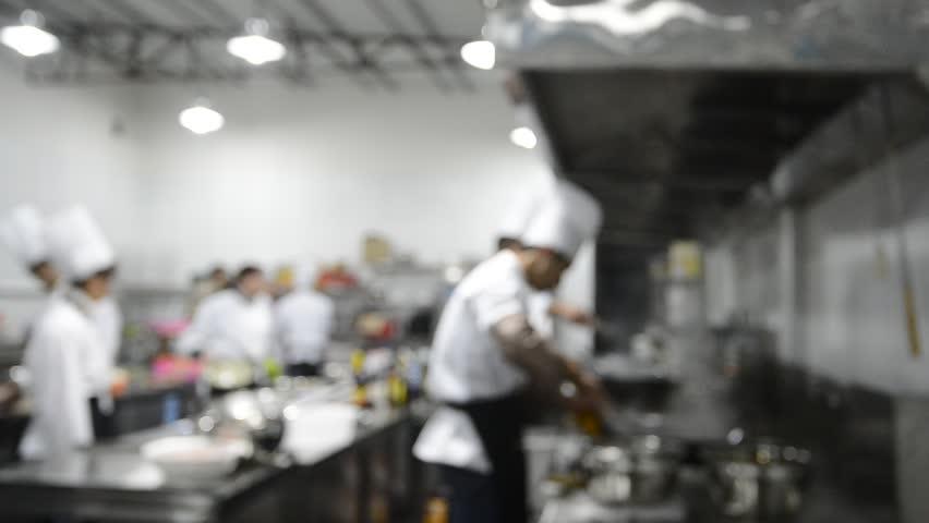 Restaurant Kitchen Chefs motion chefs of a restaurant kitchen stock footage video 7008409