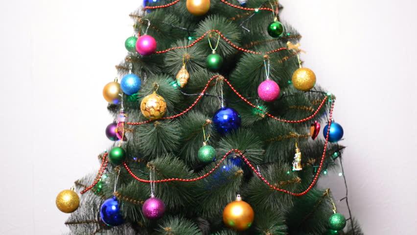 green christmas tree with gifts and bulbs rack focus and dolly in out hd - Christmas Tree Bulbs