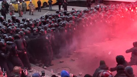 KIEV - DEC 1 2013:Ukraine Kiev. Storming of the presidential administration. Protesters clash with police