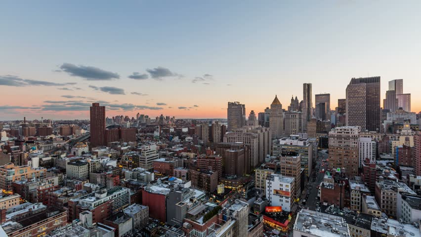 NYC cityscape panning time lapse of downtown financial district during beautiful sunset.