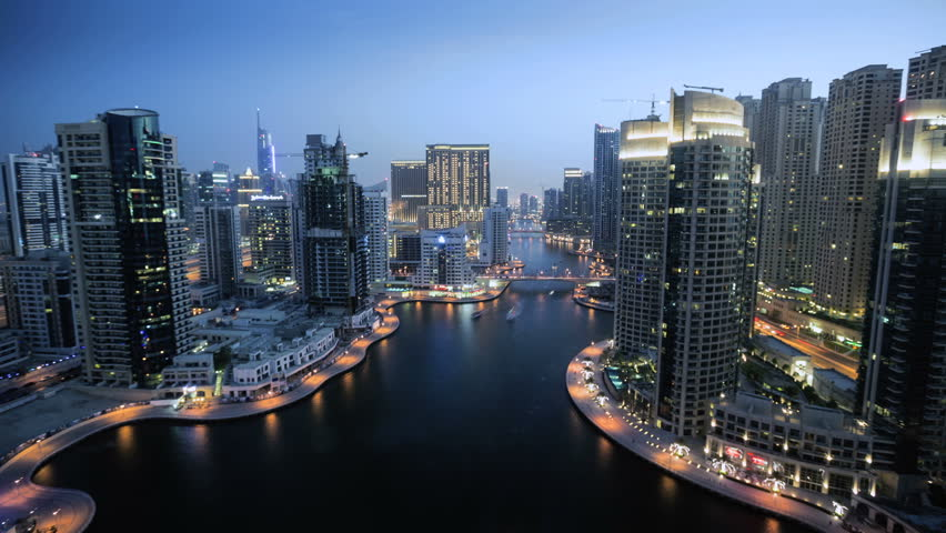 Dubai Marina time lapse, day to night transition overlooking the area's skyscrapers and waterways. Dubai, United Arab Emirates