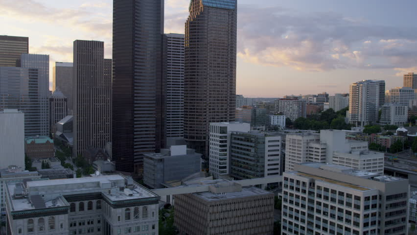 Aerial Skyscraper view at sunset with sun flare Columbia Center modern skyscraper Highway 5 Seattle, Pacific Seaport, Washington State, Pacific Northwest, USA, RED EPIC, 4K, UHD, Ultra HD resolution | Shutterstock HD Video #5300489