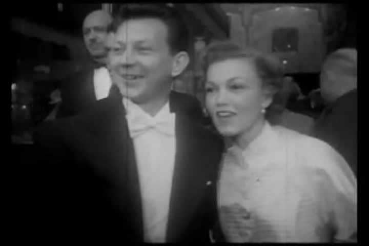 1951 newsreel story depicting the 24th Academy Awards at the Pantages theater in Hollywood. Jimmy Stewart, Shelly Winters, and Humphrey Bogart are in attendance.