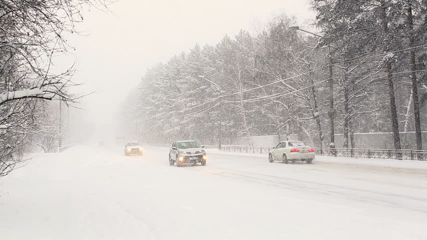 Movement of Vehicles in Difficult Weather Conditions. snowy day