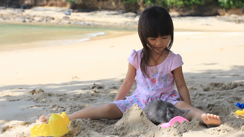 Cute Baby Girl Playing With Bear Marionette On Beach-3387