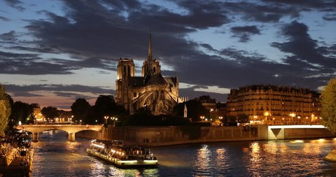 Paris City Illuminated Dusk Night Light Nighttime, Tourist Passengers Enjoy Boat Trip on Seine River near Notre Dame Cathedral Church ( Ultra High Definition, Ultra HD, UHD, 4K, 2160P, 4096x2160 )