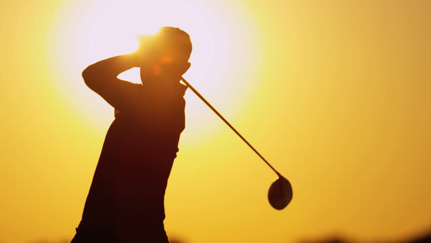 Male Caucasian golfer in sunset silhouette enjoying vacation luxury resort using driver to tee off golf course fairway slow motion shot on RED EPIC, 4K, UHD, Ultra HD resolution | Shutterstock HD Video #5336957