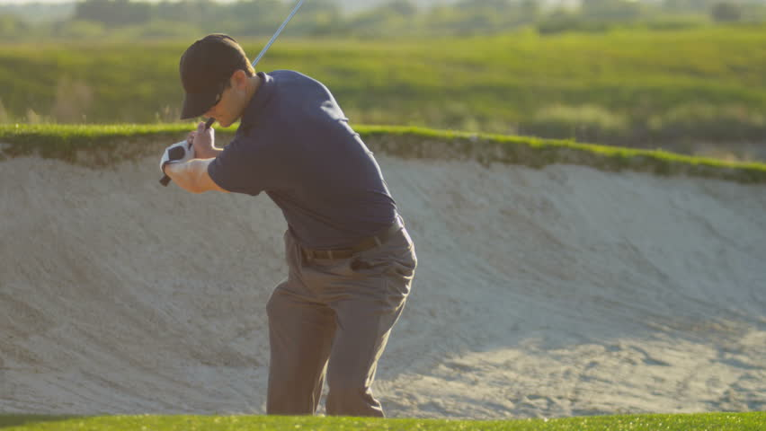 Professional male Caucasian golfer standing sand bunker golf course vacation resort playing ball shot on RED EPIC, 4K, UHD, Ultra HD resolution