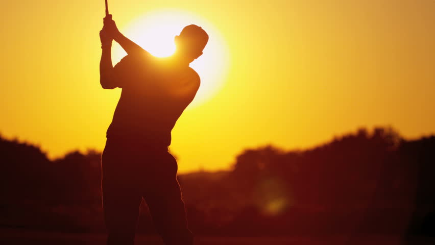 Male Caucasian golfer in sunset silhouette enjoying vacation luxury resort using driver to tee off golf course fairway slow motion shot on RED EPIC, 4K, UHD, Ultra HD resolution | Shutterstock HD Video #5337584
