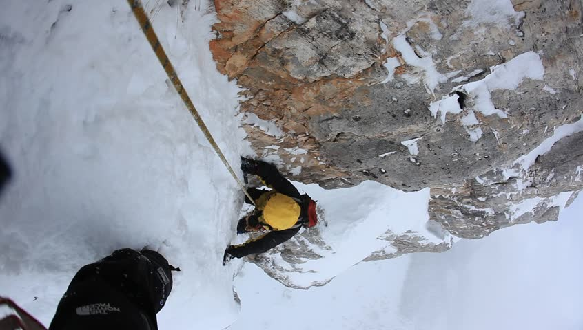 A dengerous pitch during an extreme winter climbing. Dolomiti (East Alps), Trentino, Italy, Europe.