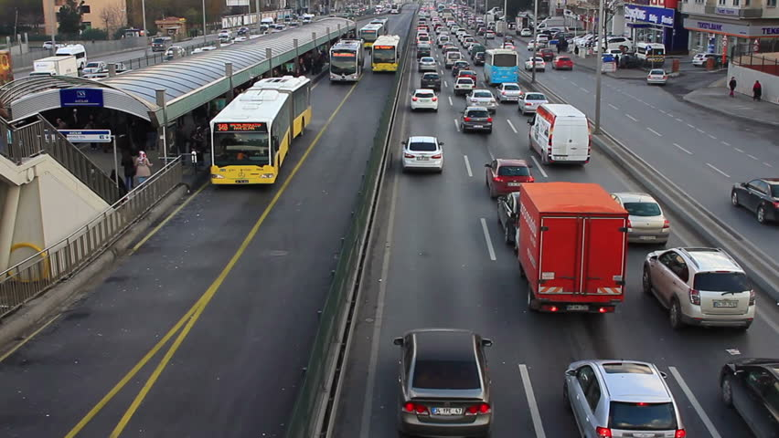 ISTANBUL - DECEMBER 14, 2013: City traffic on Avcilar bus stop. Metrobus line planed as a solution to transport problem with daily capacity of 800,000 passengers day. Heavy traffic in AVCILAR.