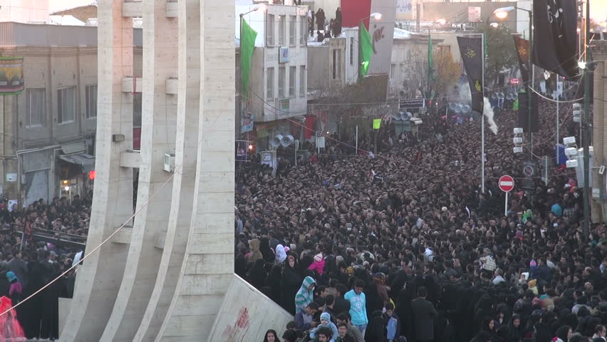 ZANJAN, IRAN - 15 NOVEMBER 2013: Massive crowds have gathered to commemorate the martyrdom of Hussain, a key figure in Shia Islam, in the streets of Zanjan, Iran #5388029