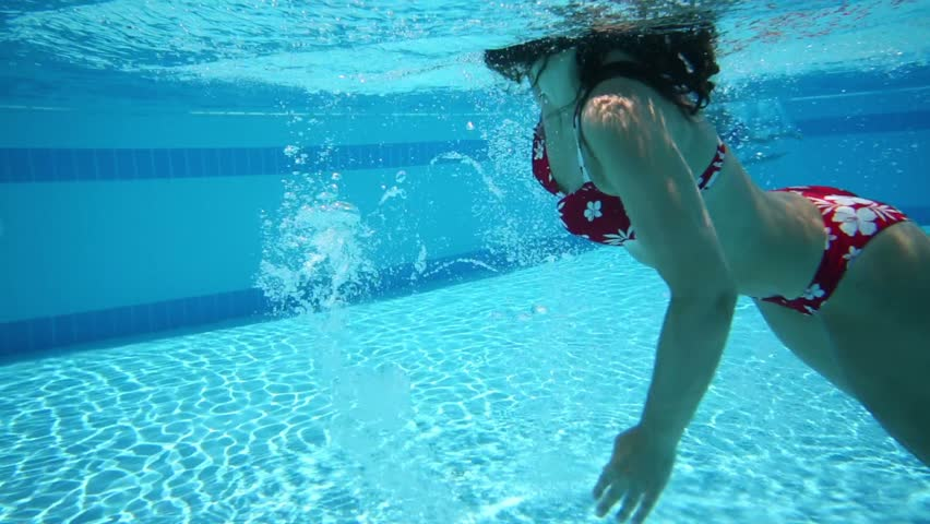 Underwater View To Swimming Woman In Outdoor Pool With