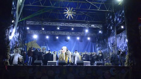 Kiev ukraine –january 06, 2014: clericals congratulates the publics by  introductory speech  east christmas evening celebration on euromaydan