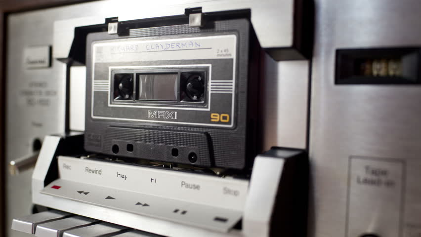 Sequence of old audio cassettes in a retro tape player. this is a super high quality 4k version at 4096x2304 pixels   Shutterstock HD Video #5413709