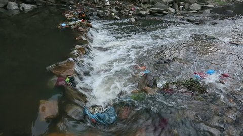 Environmental problems. Plastic Contamination into Nature. Garbage and bottles floating on water. Environmental pollution in the Himalayas. Garbage in the water of river Bagmati. (HD)