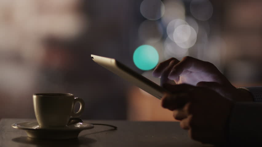 Man Using Tablet PC and Drinking Coffee in Cafe. Close-Up.Shot on RED Digital Cinema Camera in 4K(ultra-high definition (UHD)),so you can easily crop, rotate and zoom, without losing quality! | Shutterstock HD Video #5429621