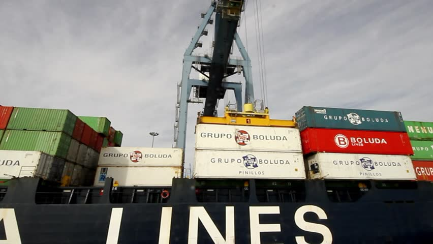 "ALICANTE, SPAIN - JANUARY 16: The containership ""Beatriz B"" of Boluda Lines Ships works unloading container helped by special crane in Alicante harbor, on january 16, 2014 in Alicante."