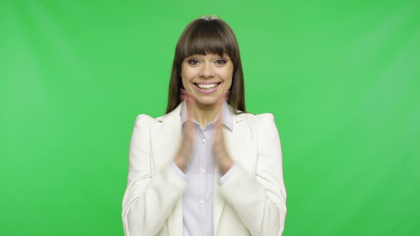 surprised excited smile business woman wear white suit, businesswoman hold raised fist palms hands over green screen chroma key background