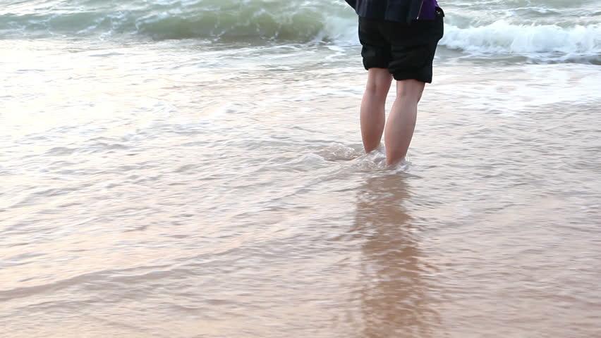 Walking alone on the beach | Shutterstock HD Video #5440739