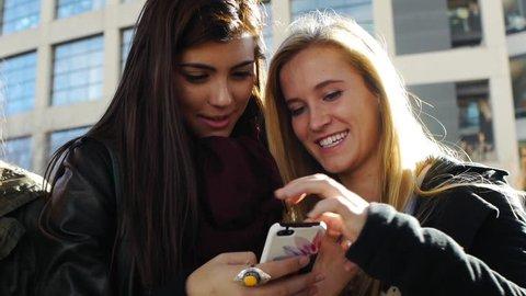 Four Teen Girls Taking Paired Selfies