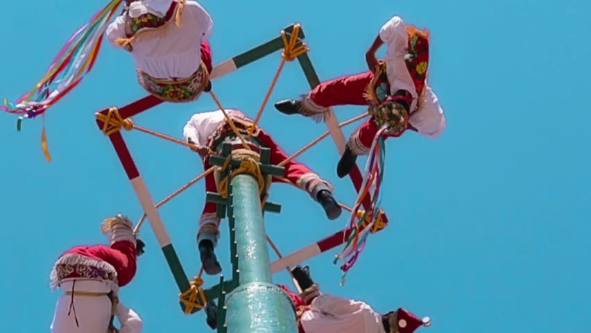 TOTONOCAPAN, MEXICO, 10 JANUARY 2014: Men called Voladores de Papantla, making their dance on the air for fertility of the earth during a town festivity