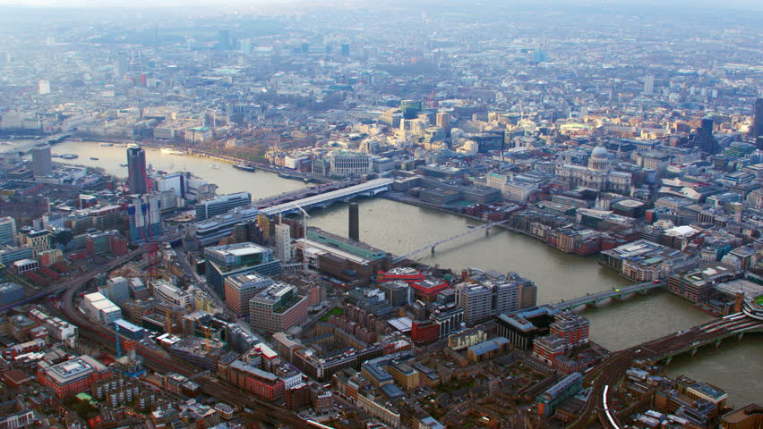 4K Aerial shot of Central London with view of the River Thames, St Paul's Cathedral, Blackfriars, Tate Modern, Millennium Bridge, Shard, Cannon Street Station | Shutterstock HD Video #5520029