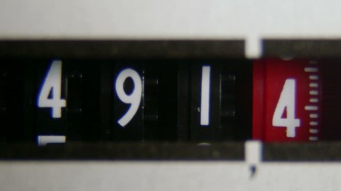 Electricity meter display dial extreme close-up time-lapse