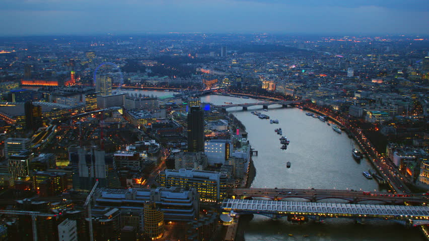 4K Aerial shot of Central London at night with view of London Eye, River Thames, OXO Tower, Blackfriars Bridge, Houses of Parliament, Big Ben, Waterloo Station | Shutterstock HD Video #5550569