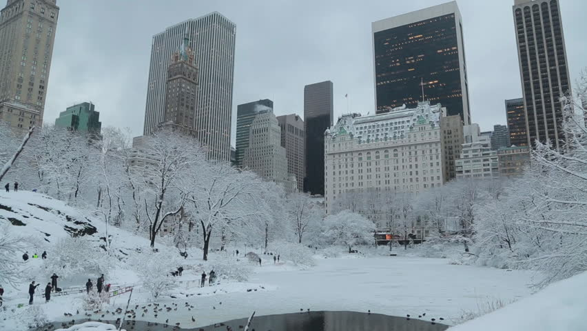Central Park and Manhattan buildings in New York City snowing pan