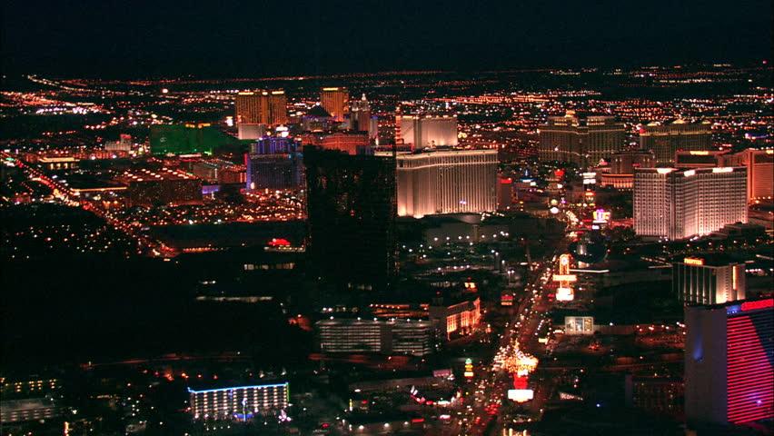 LAS VEGAS, USA - 1 January 2011 - Hotel Strip Night Las Vegas. Aerial footage of the Las Vegas strip at night. Beautiful hotel and skyscrapers light up the city skyline.   Shutterstock HD Video #5575439