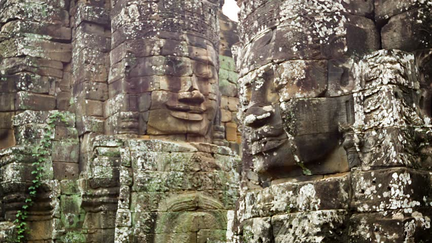 Video 1920x1080 - Huge stone faces on the towers of the ancient temple. Bayon. Angkor. Cambodia