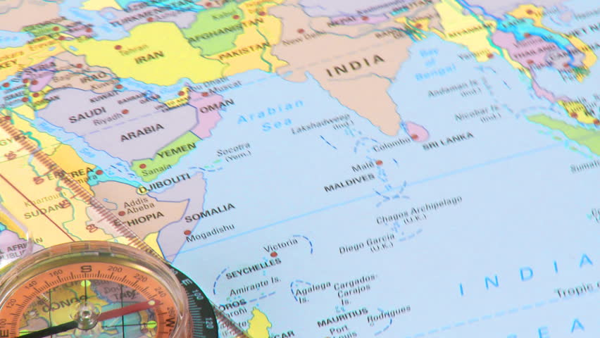 Close up of a detailed world map stock footage video 6061967 high view of a compass and world map turning hd stock video clip gumiabroncs Image collections