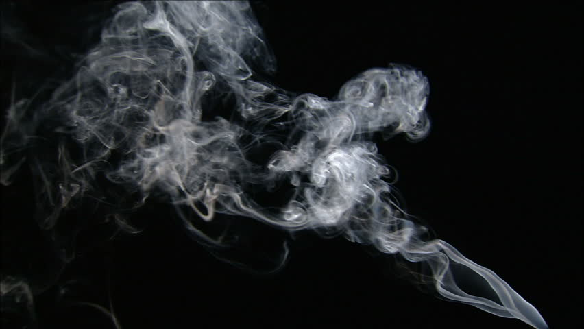Trail of smoke coming up from the right side of the screen, on a black background.