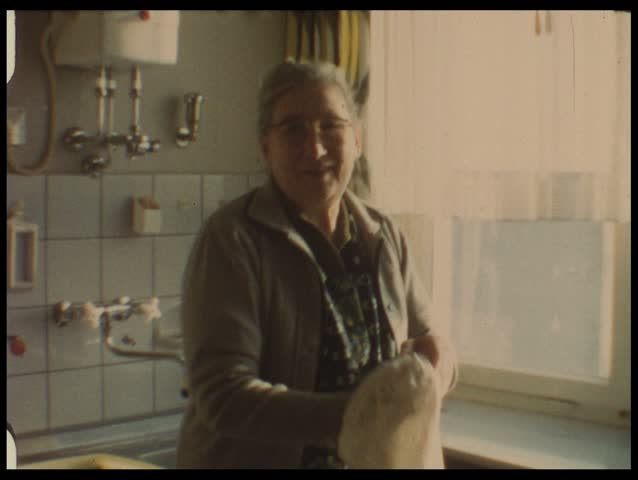 Grandma in kitchen (vintage 8 mm film)