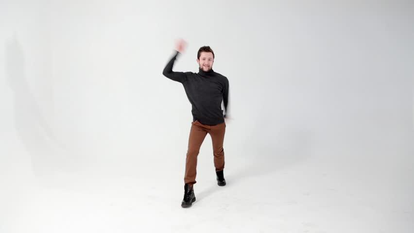 Bearded man happily dancing | Shutterstock HD Video #5624639