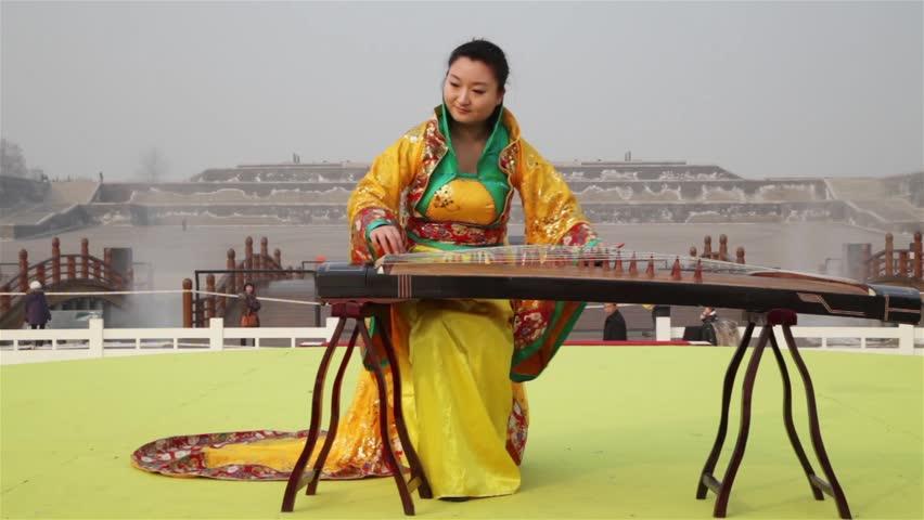XI'AN-JAN 27: Girl playing the guzheng, a traditional Chinese string instrument , Jan 27, 2012, Xi'an city, Shaanxi province, china.