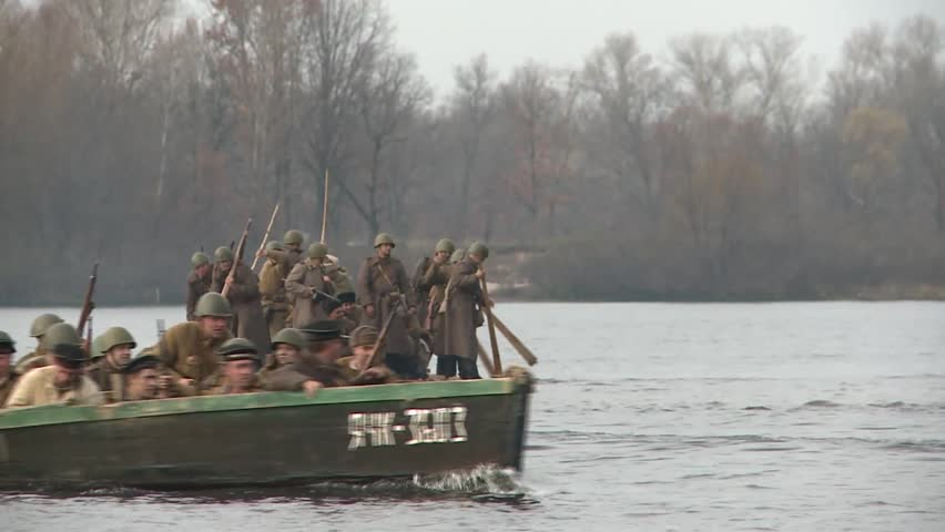KIEV, UKRAINE - NOVEMBER 04, 2013 : 04.11.2013. Reconstruction of the hostilities of the Second world war in Kiev. The soldiers are forcing the Dnieper river near Kyiv, and attack the enemy.
