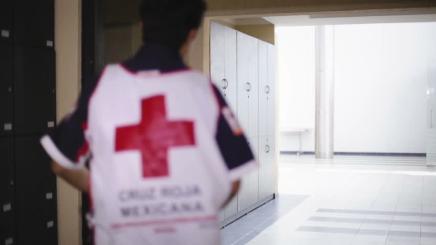 GUANAJUATO, MEXICO CIRCA FEBRUARY 2014: Paramedics of the red cross running after receive an emergency call during a simulated exercise