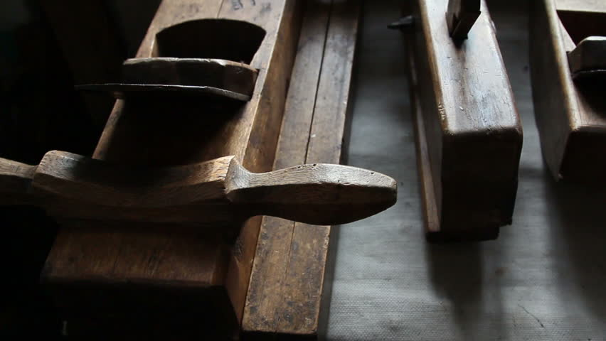 Set of old wooden carpentry tools displayed on the table
