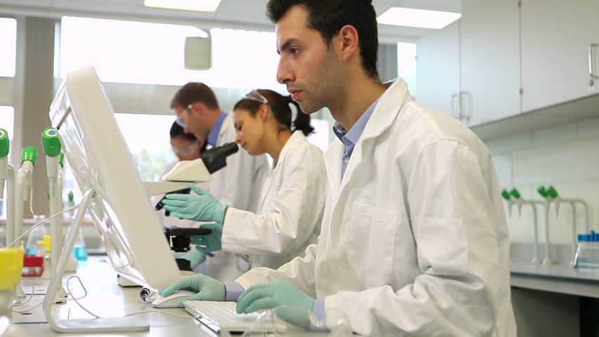 Team of serious science students working together in the lab at the university | Shutterstock HD Video #5669369