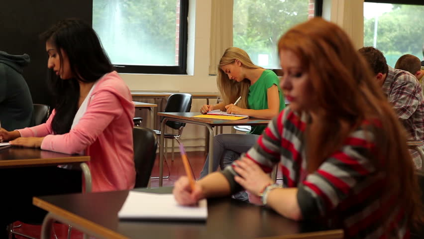 Concentrating students sitting in class and taking notes in a college | Shutterstock HD Video #5669597