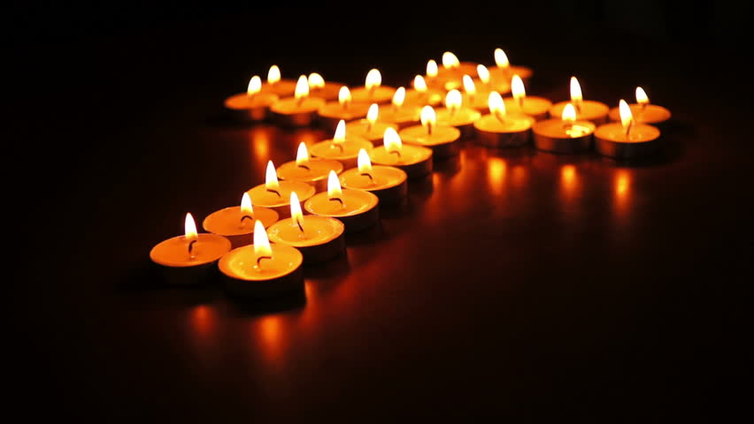 ... Circular shallow depth of field dolly shot of many candles arranged into a spiritual ... & Candle Light Free Video Clips - (1158 Free Downloads)