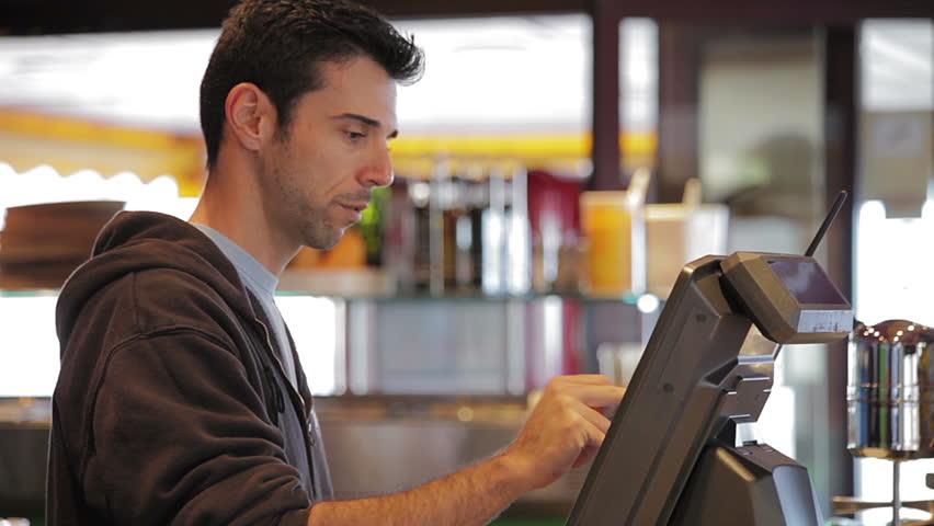 Stock video of man at cash register - close   5717759