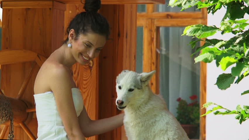 Young beautiful brunette and her devoted pet. Devoted pet.