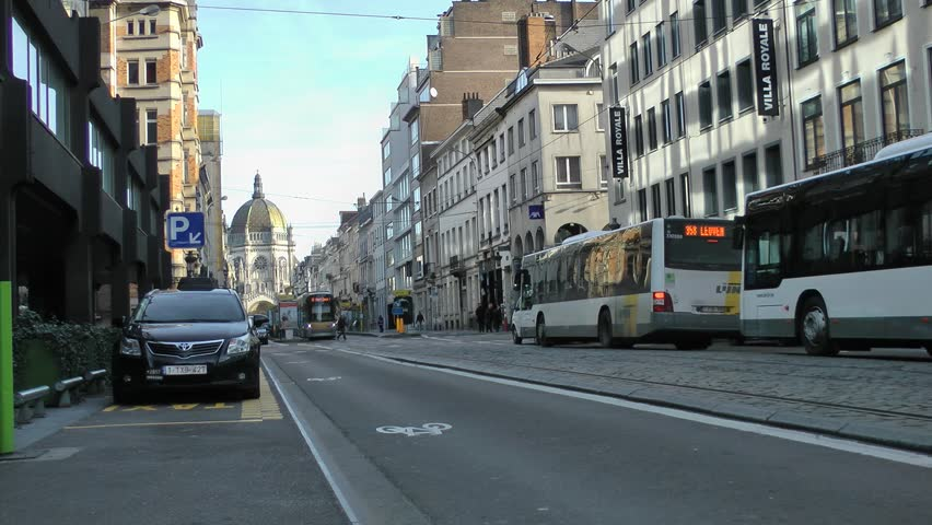 BRUSSELS - FEB 2014:Trams, Buses, Cars - street view traffic