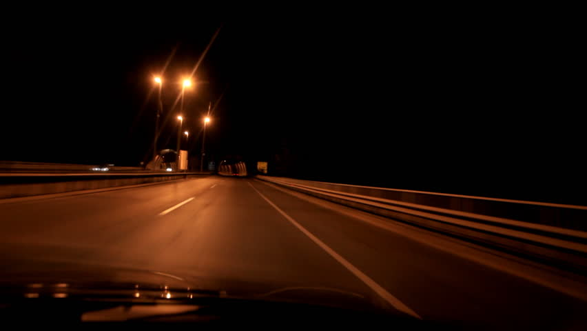 HD 1080: driving car at night; camera mounted inside car;