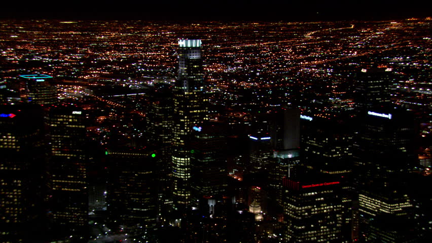 Downtown Los Angeles Night. This clip is an aerial shot of downtown Los Angeles, California at Night, It zooms out to show all of the buildings that are lit up.
