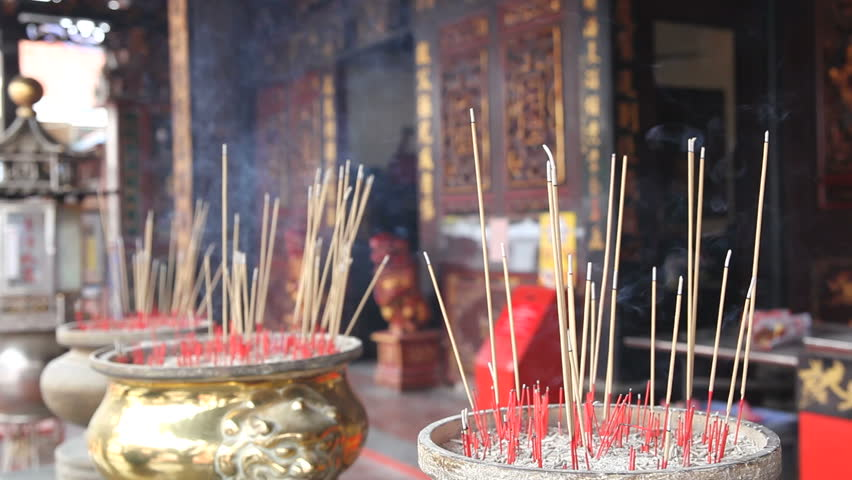 Burning Incense Joss Sticks for Blessings in Buddhist Temple 1920x1080