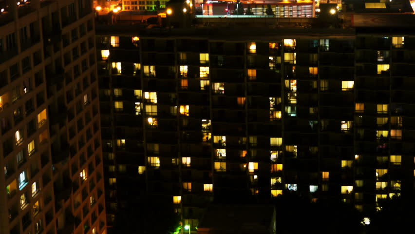 Time Lapse of Apartment Building at Night -Pan- | Shutterstock HD Video #5759579